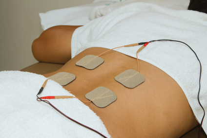 Patient  applying electrical stimulation therapy ( TENS ) on his back